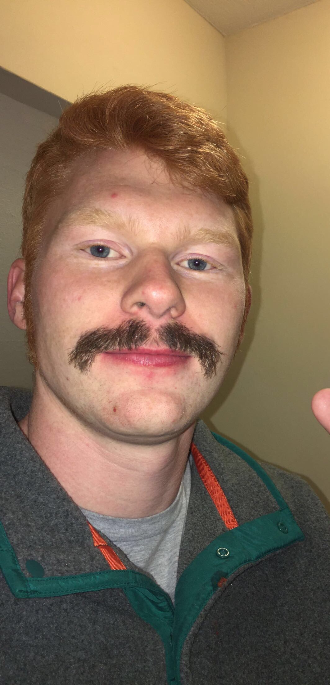 Mike Davidson shows off his dyed mustache.