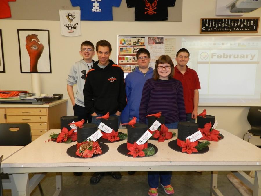 Adaptive tech ed students construct snowmen hat centerpieces