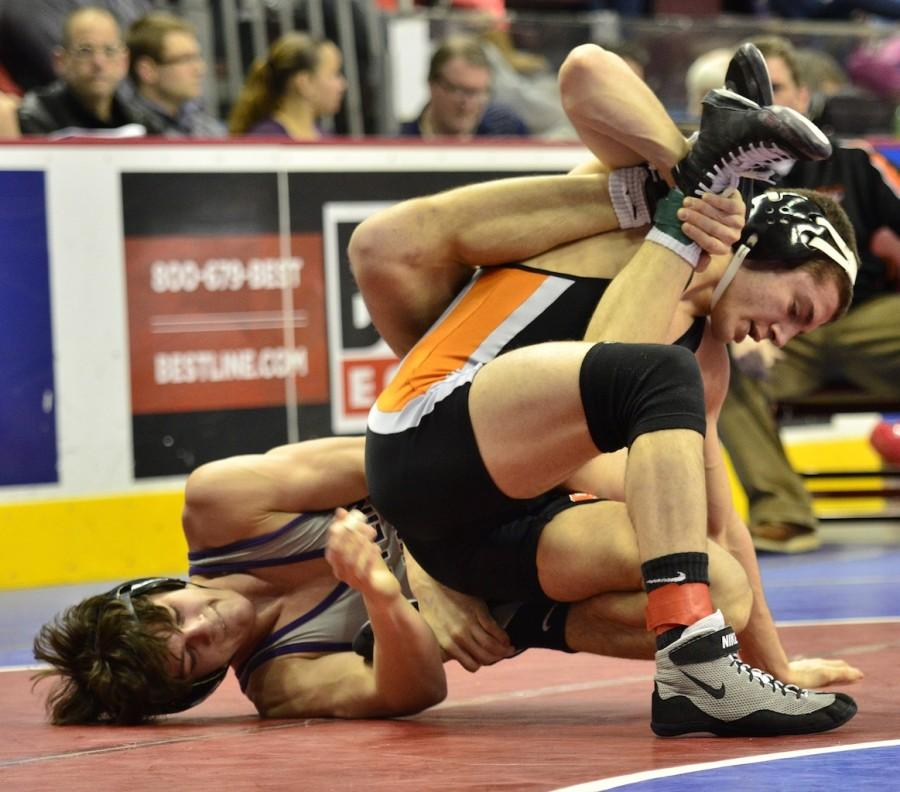 Mifflin County's Noah Stewart, left, works to get around on Paul Dunn of Bethel Park in a 160-pound quarterfinal match Friday, March 6 in the PIAA Class AAA Wrestling Championships at Hershey.