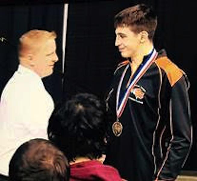 Bonaccorsi receives his 6th place medal from Coach Bob Stewart.