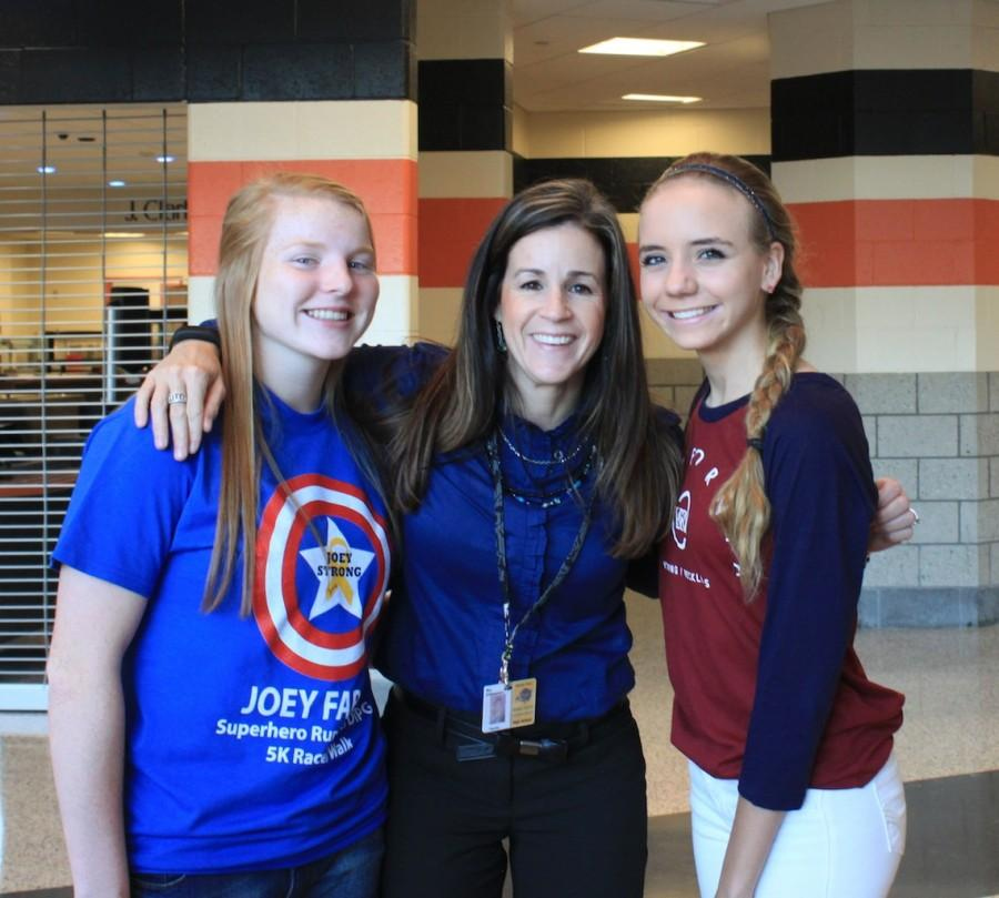 Students and staff pose in blue on Blue T-shirt Day.