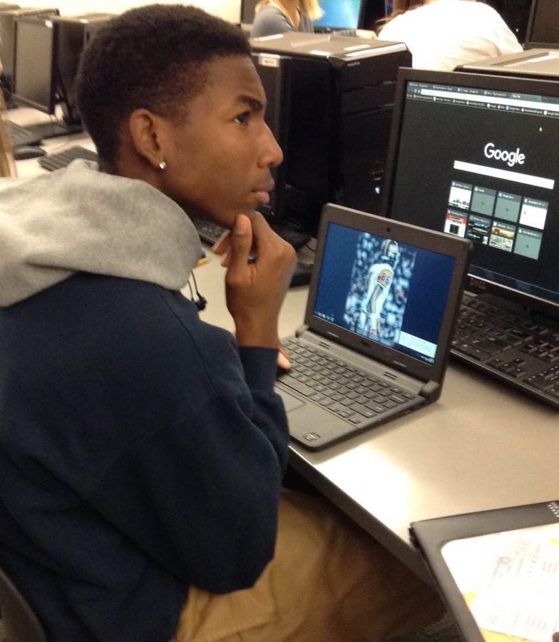Senior Brendan Todd contemplates the essence of the Chromebook.