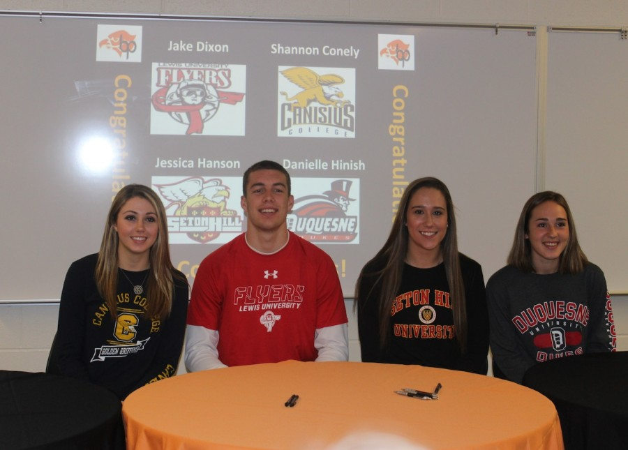 Seniors Shannon Conely, Jake Dixon, Jessican Hanson, and Danielle Hinish pose for a pic at the ceremony honoring the signing of their National Letters of Intent.