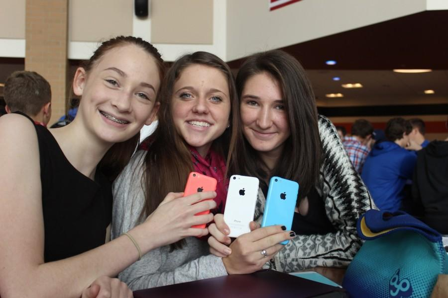Sophomores Hannah Hathaway, Meredith Heh, and Kelsey Thomson pose with their red, white, and blue phones.