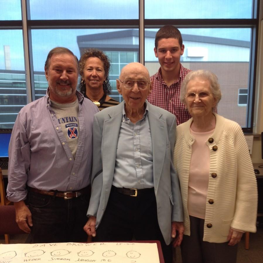 Mr. Bill Hosking, World War II veteran, poses for a pic with his family.