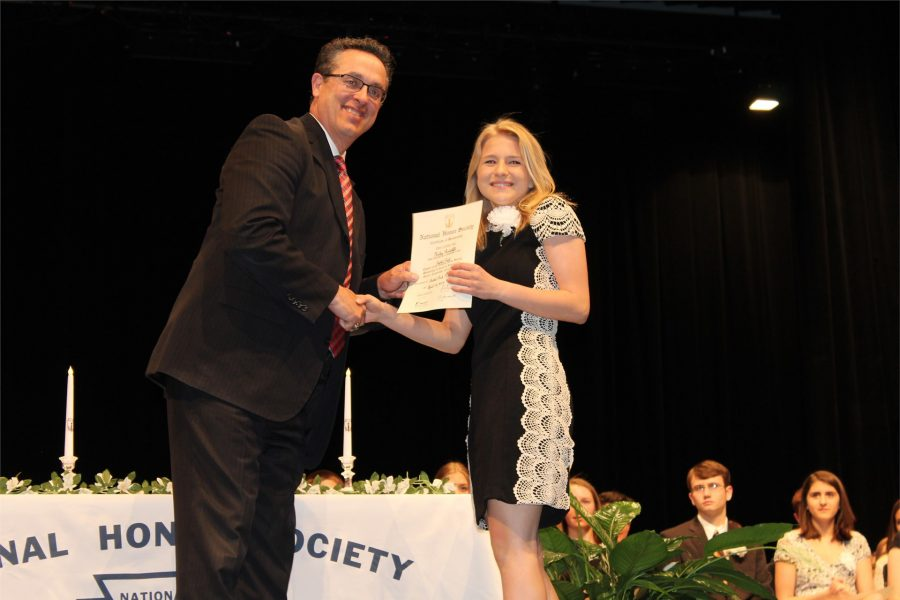 Sophomore Haley Radcliffe is all smiles as she receives her NHS certificate from Dr. J.