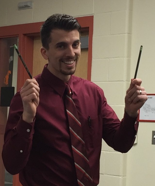 Allemang is all smiles as he holds his two Triconderoga™ pencils.
