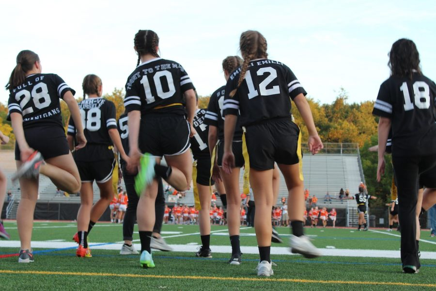 Senior PowderPuff players do a little dance at the game.