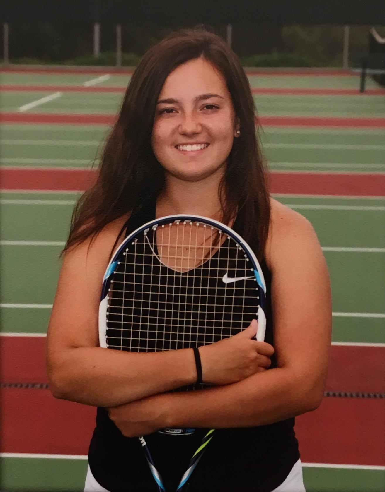 Emily Kramer poses with her tennis racket.