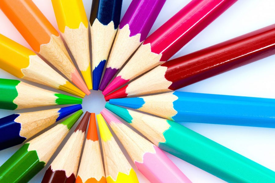 Adult Coloring Books A Synonym For Stress Relief Many Different Colored Pencils On White Background