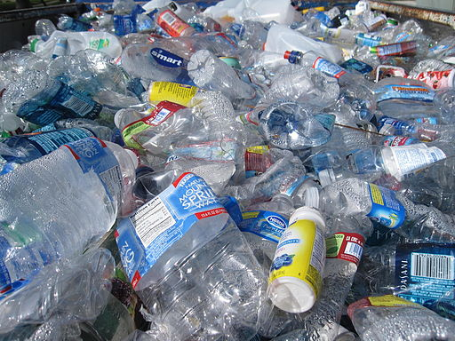 Plastic bottles in the back of a pickup truck, ready for recycling