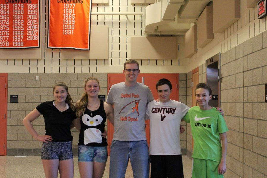 Pole+vaulters+Maddie+Werner%2C+Rebecca+Libell%2C+Ryan+Tischler%2C+and+Chris+Garland+pose+with+Coach+Jacobs.+Not+pictured%3A+Kat+Kimes