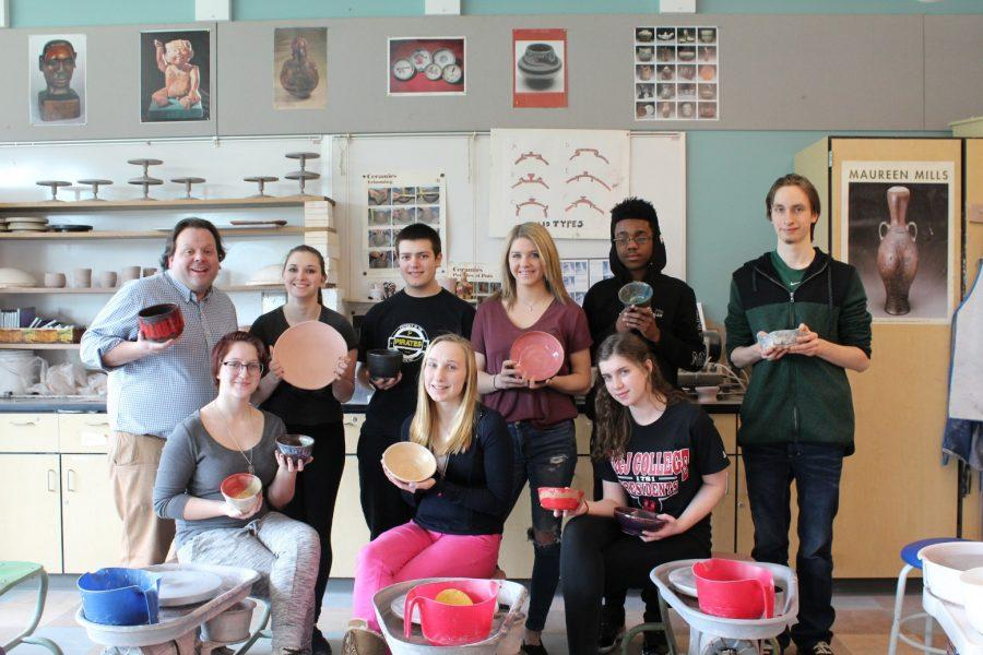 Ceramics students show off their bowls for the Empty Bowls Dinner.