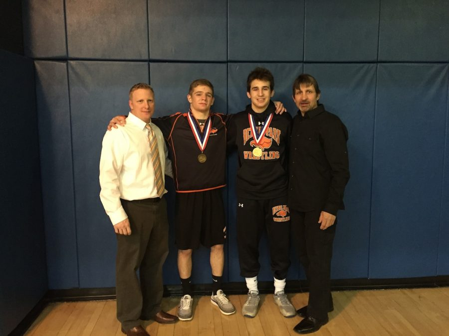 Jason Montgomery and Nino Bonaccorsi proudly show their WPIAL medals as they stand arm in arm with Coaches Stewart and Bonaccorsi.
