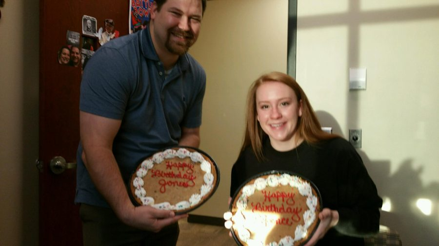 Mr. Jones and Ashley Spence show off their Happy Birthday Cookie Cakes.