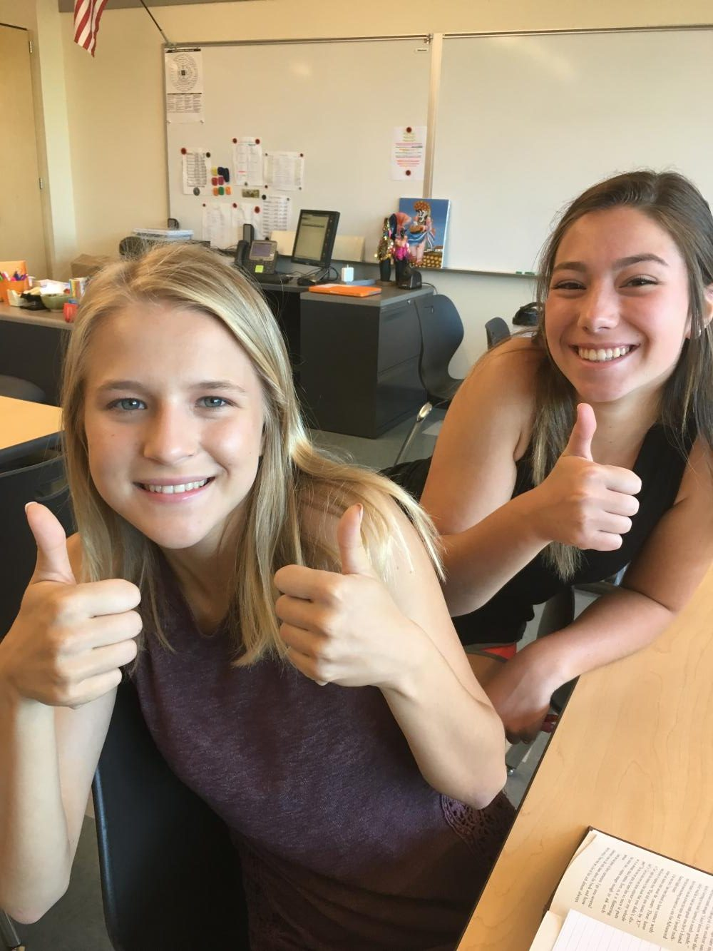Juniors Haley Radcliffe and Kayla Dell give thumbs up for Journalism class.