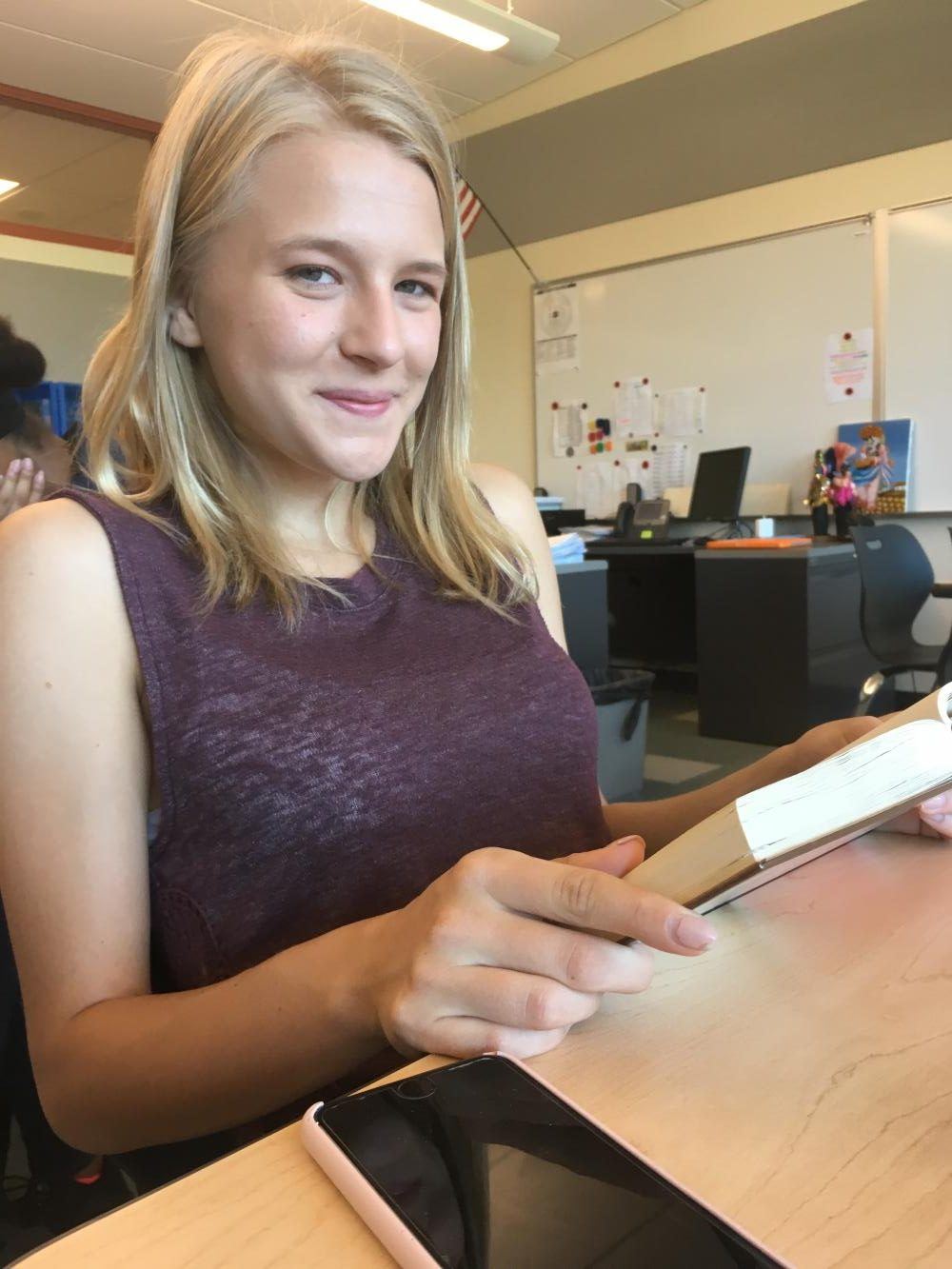 Junior Haley Radcliffe is all smiles as she delves into her summer reading.
