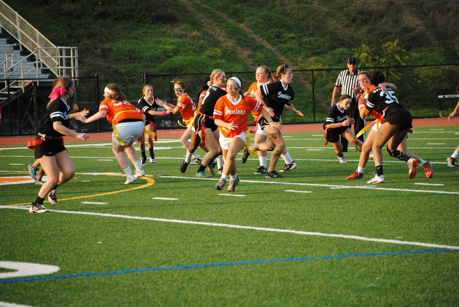 Senior and Junior powderpuff players duke it out on the field on Sunday, Sept. 17. Photo by: Amber Schnupp