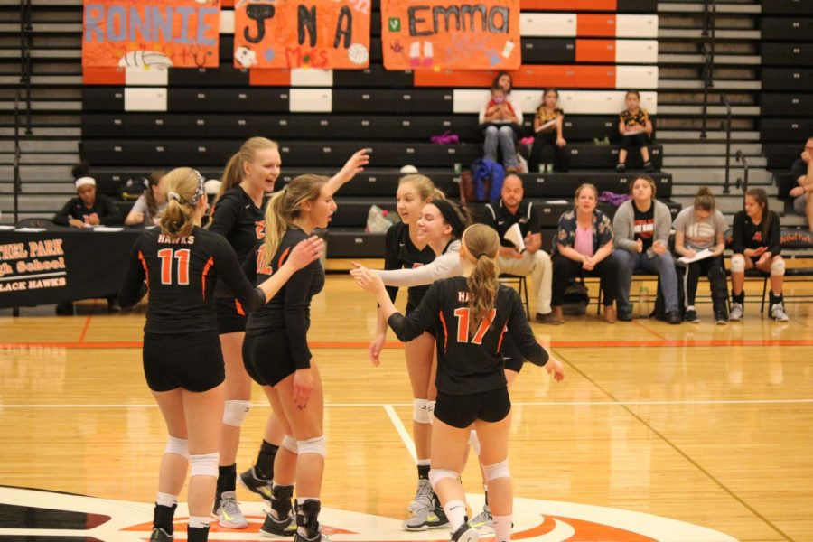 Lady Hawks congratulate each other during their game against Canon Mac on Tuesday, Oct. 17. The Lady Hawks won the match 3-1.