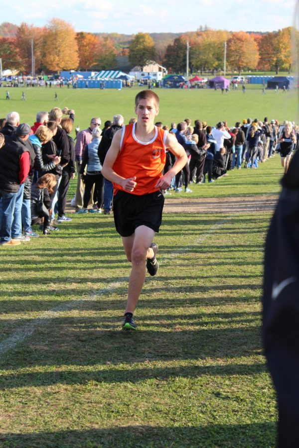 Burkhart forges his way across the 5K course at Cooper's Lake in Slippery Rock at the WPIAL Championships on Thursday, Oct. 26. Burkhart ran 16:51 and finished in 15th place overall, which qualified him for the State Championship in Hershey.