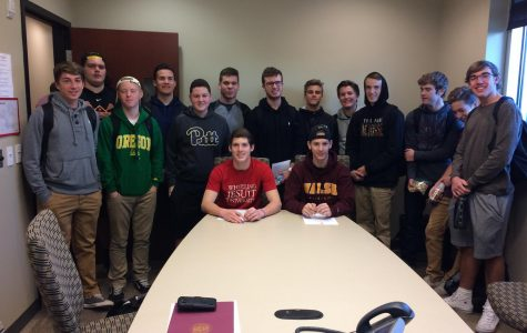 Noah Larouere and Evan Bradley sign their National Letters of Intent
