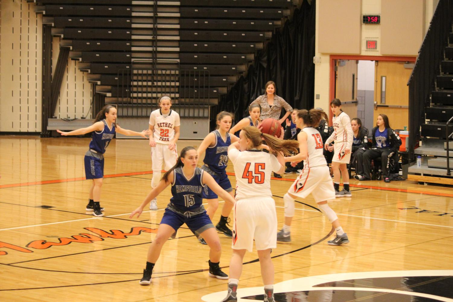Lady Hawks look to make a play against Hempfield during their first game of the Tip-Off Tournament Friday, Dec. 8.