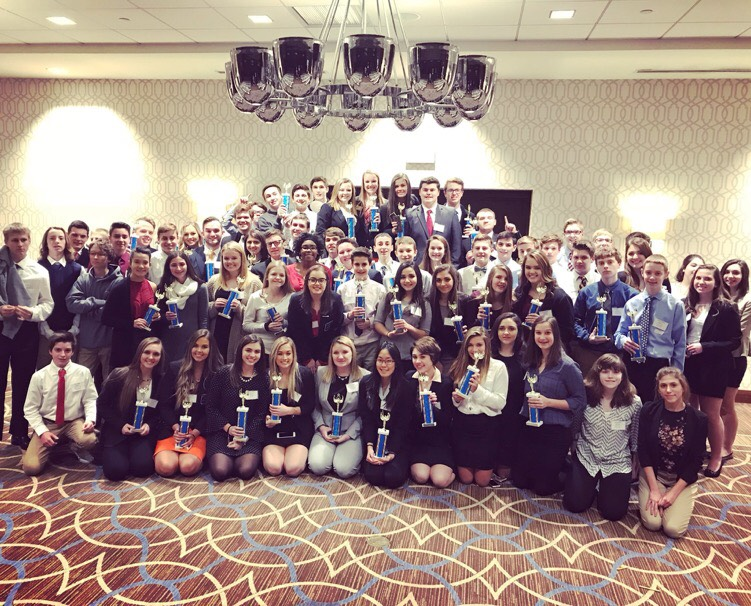 DECA+students+proudly+display+their+hardware+at+the+DECA+District+III+Career+and+Development+Conference.