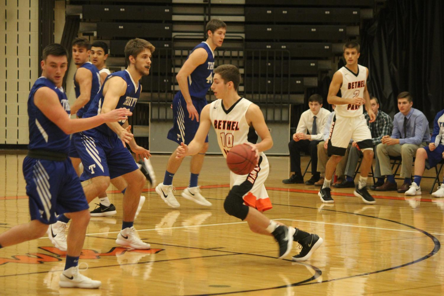 Senior Jake Nuttridge drives to the net during the boys game against Trinity on Dec. 12.