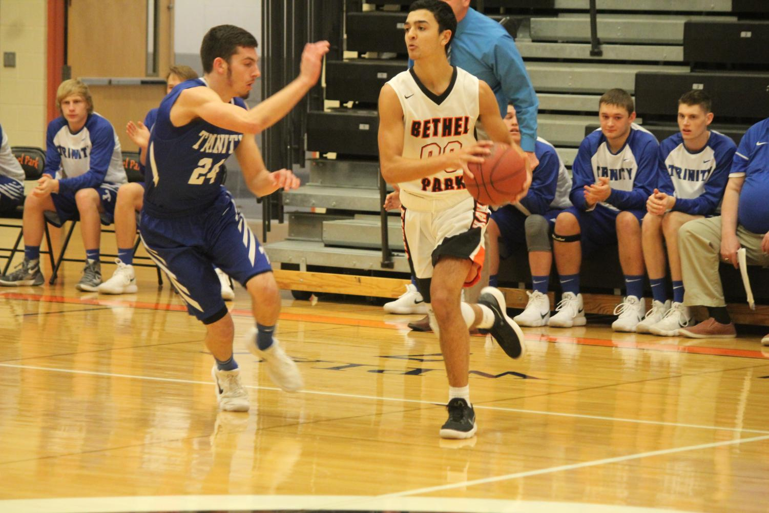 Nick Bomar looks to make a play in a game against Trinity on Tuesday, Dec. 12.