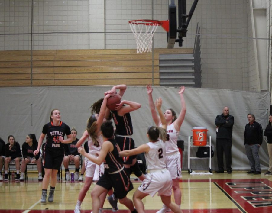 Olivia Westphal's shot is defended by a swarm of Panthers on Jan. 4.