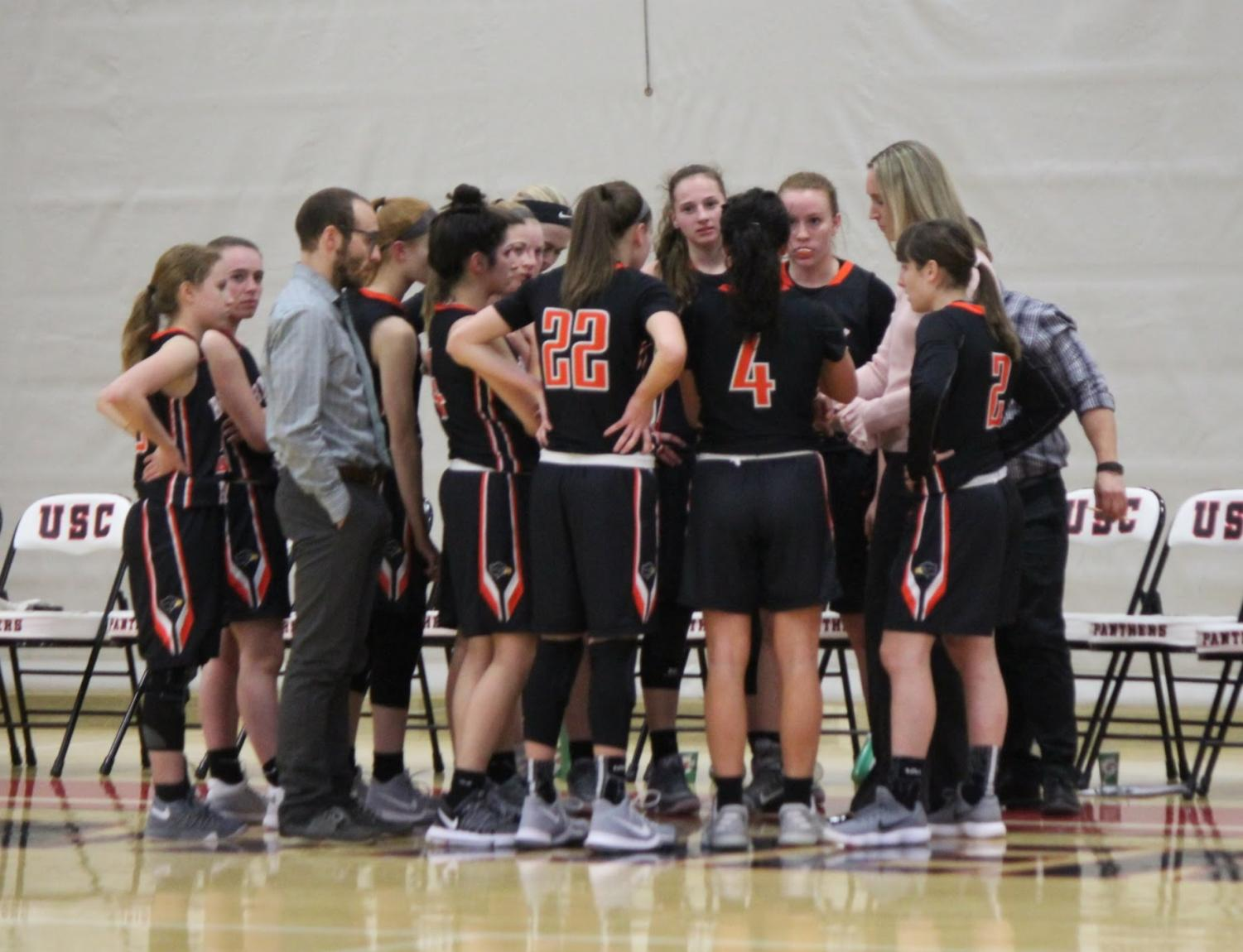 Lady Hawks huddle up during their game vs. USC on Thursday, Jan. 4.