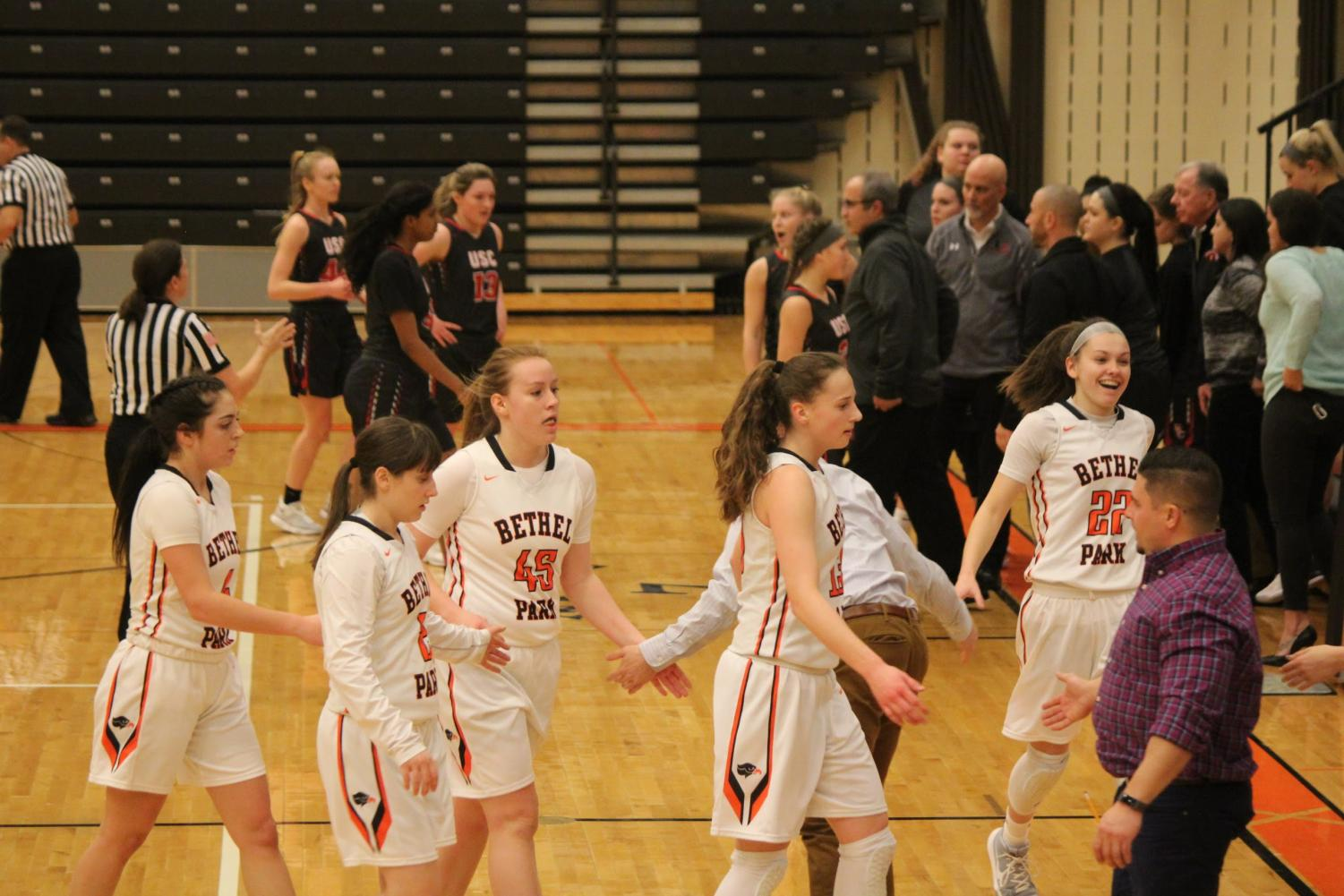 The Lady Hawks slap hands with their coaches during their game against USC on Thursday, Jan. 25.