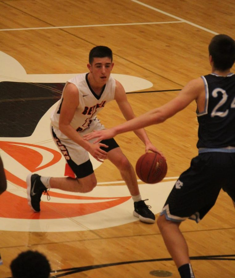 Alex+Mullen+dribbles+past+a+player+from+Central+Valley+during+their+game+on+Monday%2C+Feb.+12.