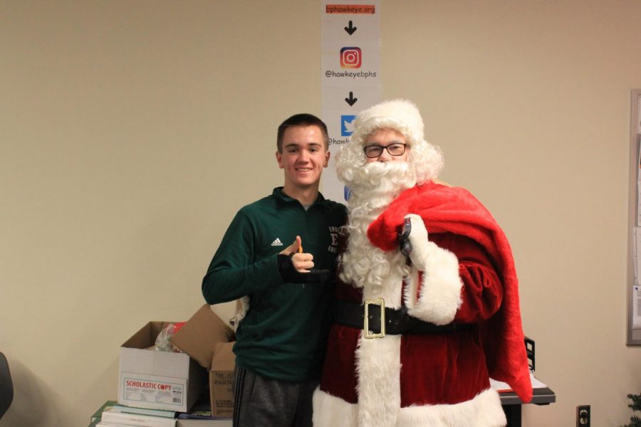 Mr. Knapp (ahem Santa) poses with sophomore Ryan Meis.