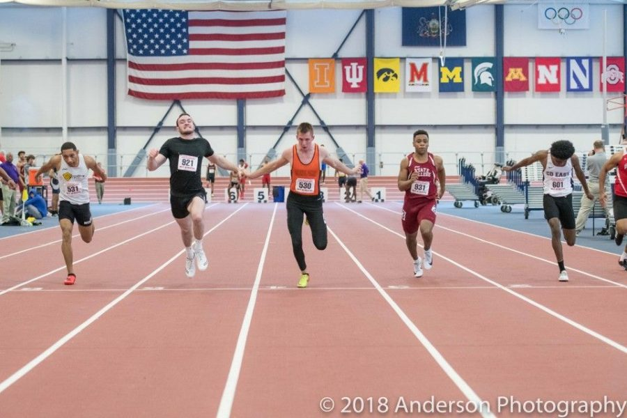 Krandel crosses the finish line in the trials of the 60 meter dash.