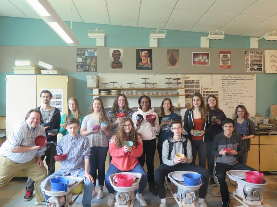 Mr.+Hooton+and+his+Ceramics+2+students+pose+with+their+bowls+they+made+for+the+Empty+Bowl+Dinner.