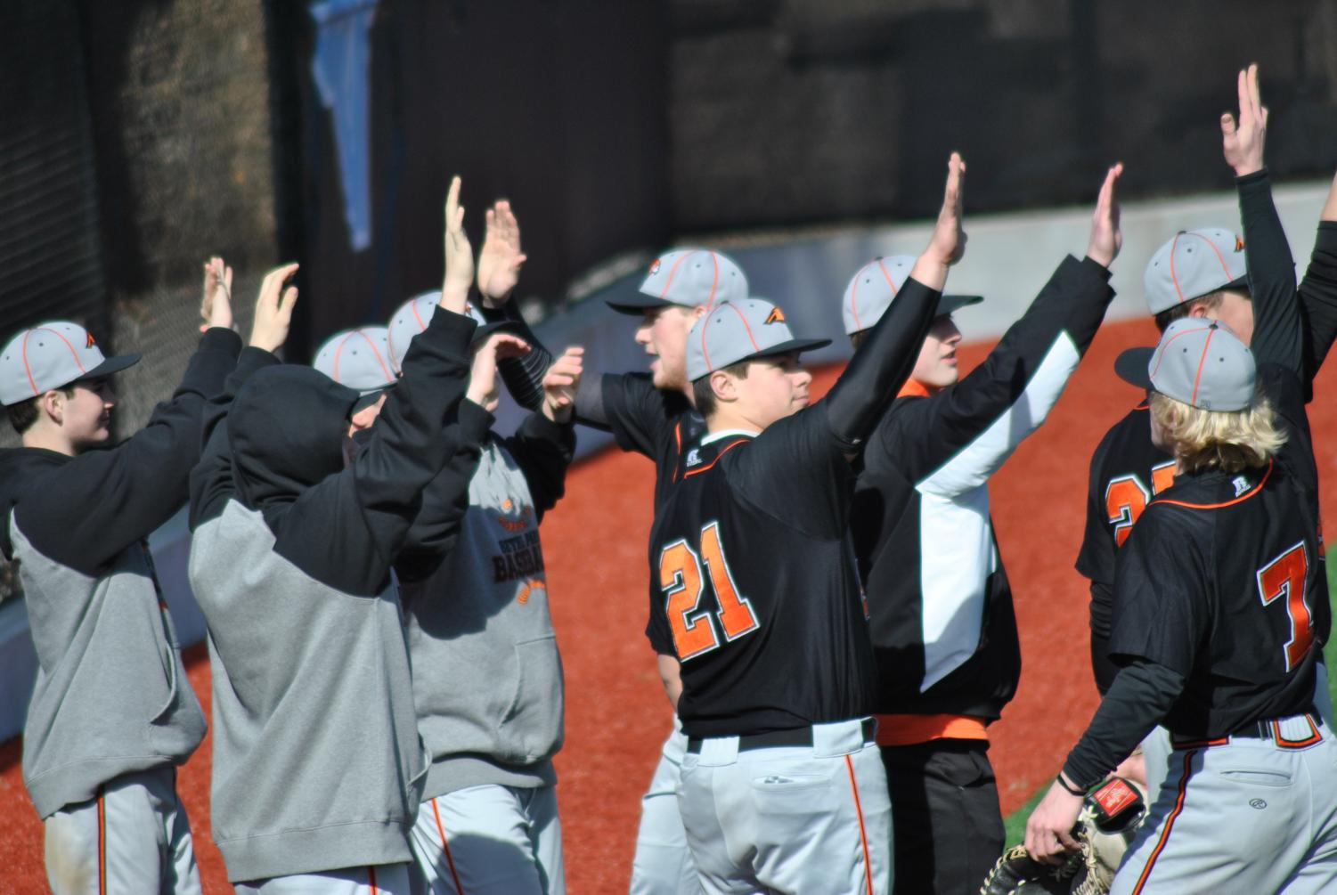Hawks are all high fives during their game against Seneca Valley earlier this season.