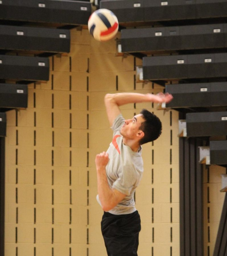 Senior+and+captain+Grant+Jansante+jumps+up+for+a+spike+during+practice+earlier+in+the+season.