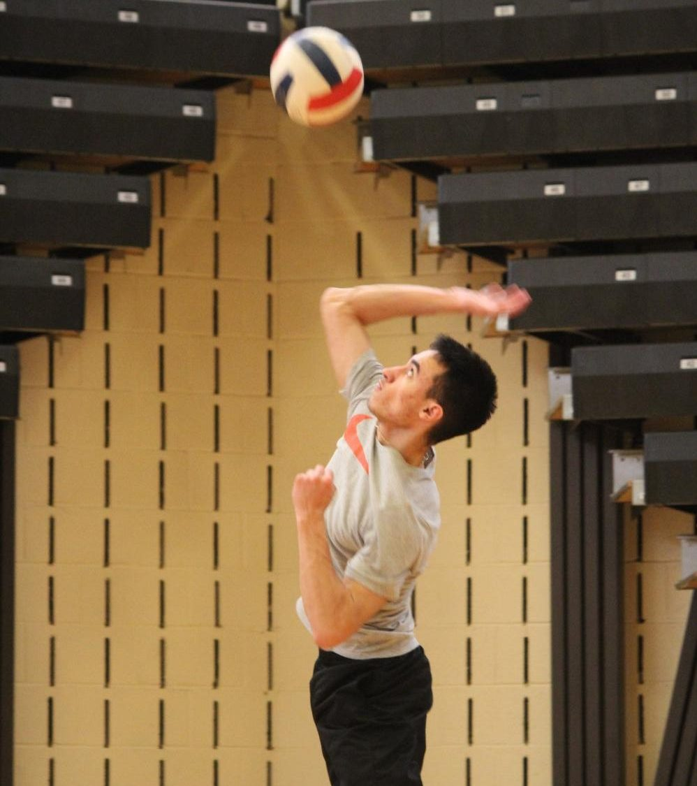 Senior and captain Grant Jansante jumps up for a spike during practice earlier in the season.