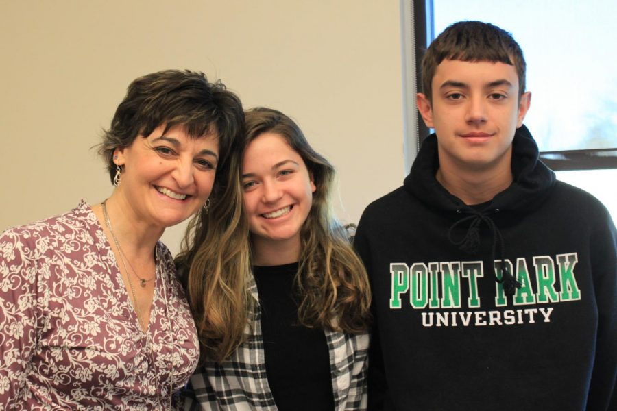 Ms. Robb poses with Lauren Mullen and Logan Wright