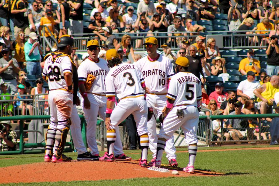 READY TO PLAY SOME BASEBALL, 2015 Pirates' infielders are standing on the mound having a meeting at PNC Park on May 10, 2015.