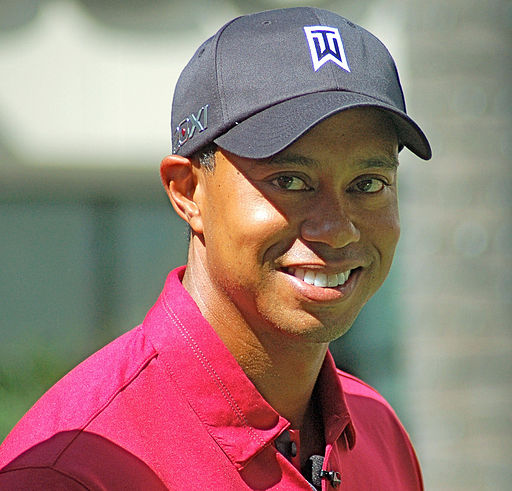 ALL SMILES, Tiger Woods attends a Chevron World Challenge charity event to putt with fans at Hollywood & Highland Center to benefit the Tiger Woods Foundation in October 2011.