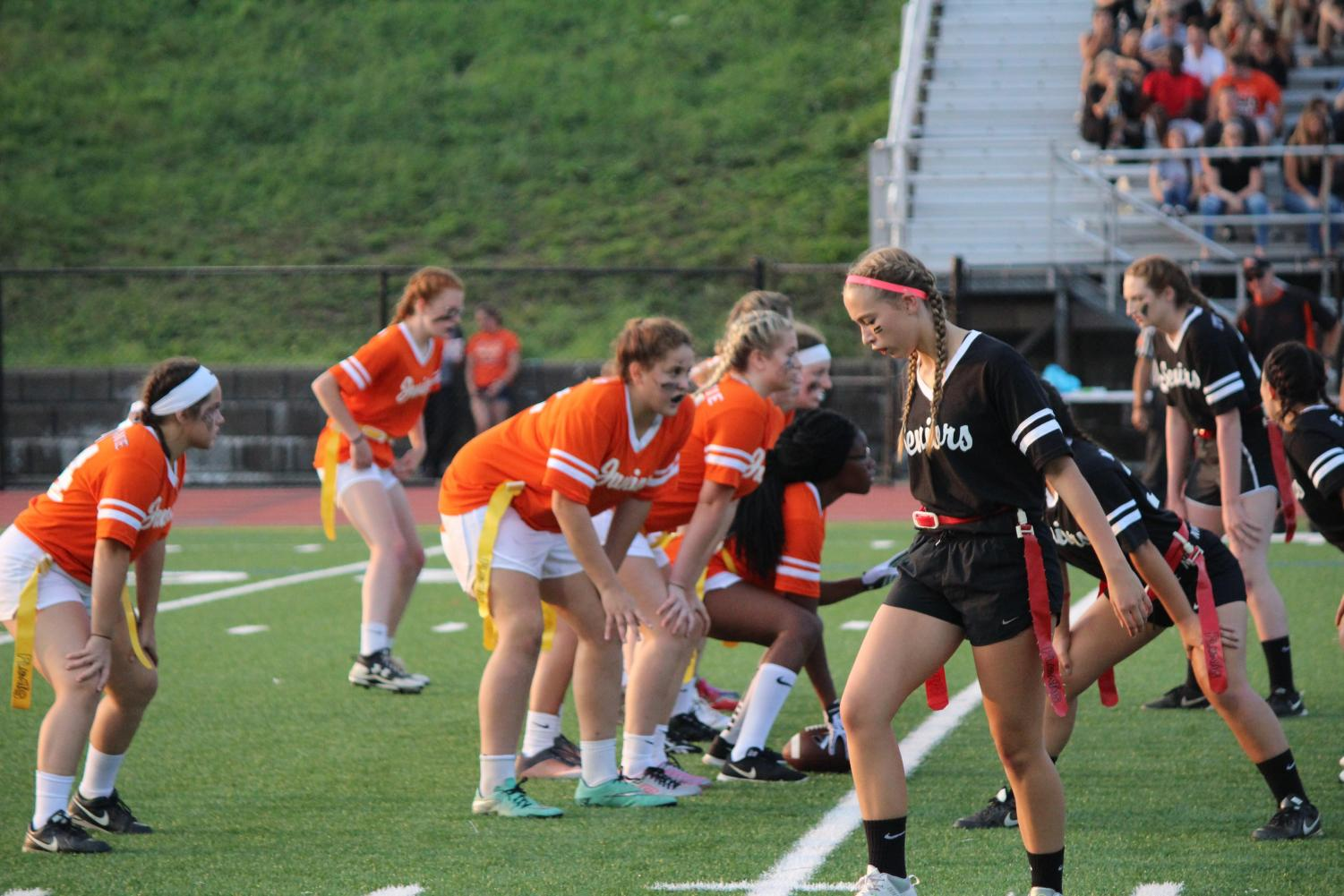 Juniors and seniors toe the line of scrimmage during their game last year. The seniors won 33-6.