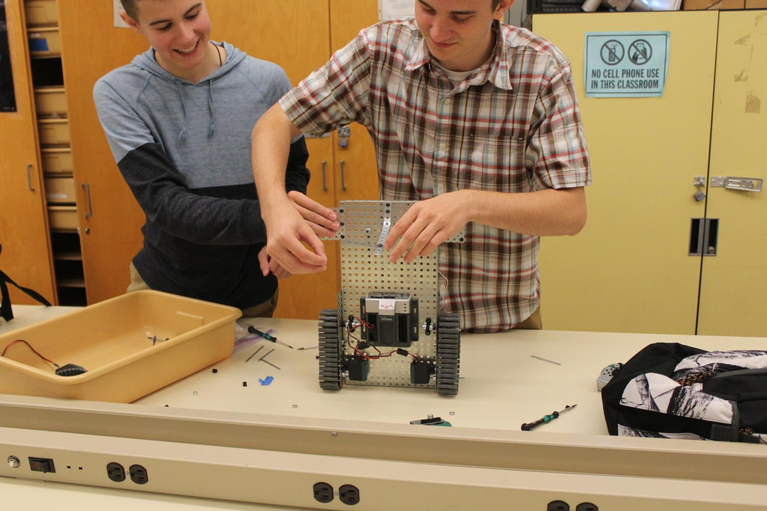 WITH CAREFUL PRECISION, CIM students, seniors Ian Materkowski and Cullen Stewart work on their robot.