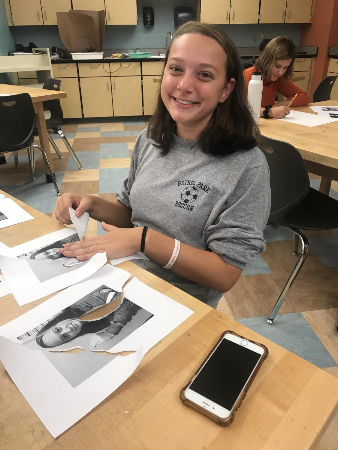 Sophia Galietta is all smiles at her work desk in the art room.