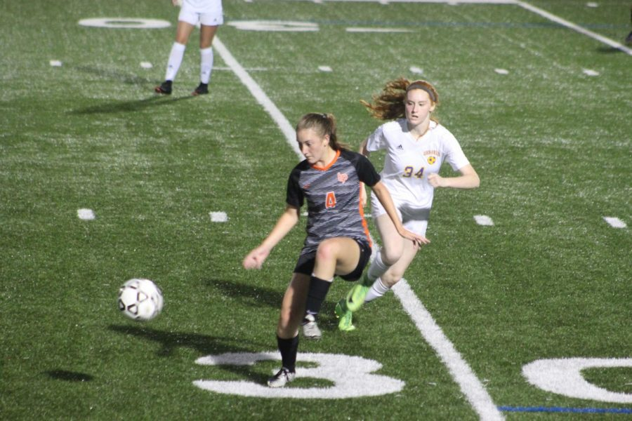 Junior Molly Hoffman accepts a pass during the Lady Hawks' game vs. the Lady Macs on Monday, Sept. 17.