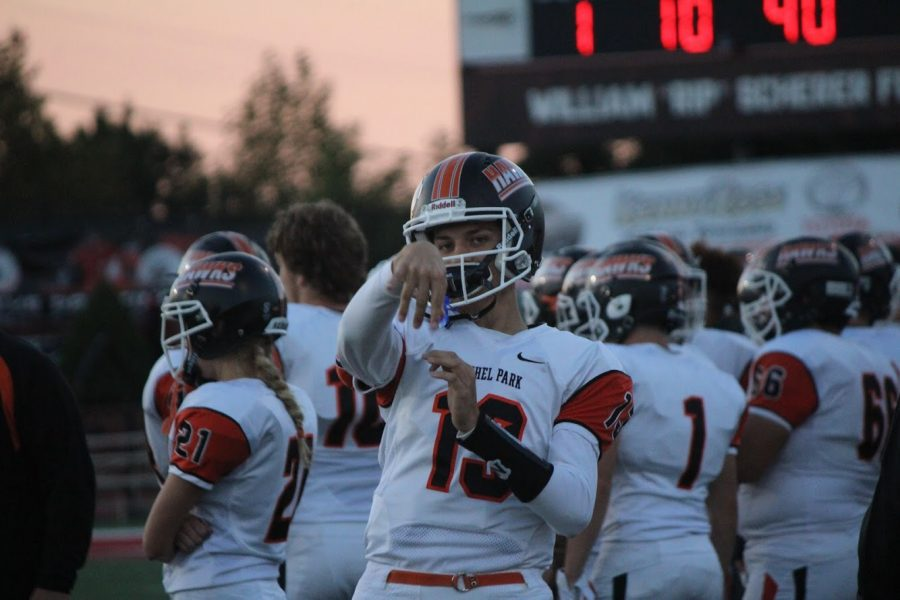 QB1+Anthony+Chiccitt+warms+up+before+leading+the+offense+on+Friday+night