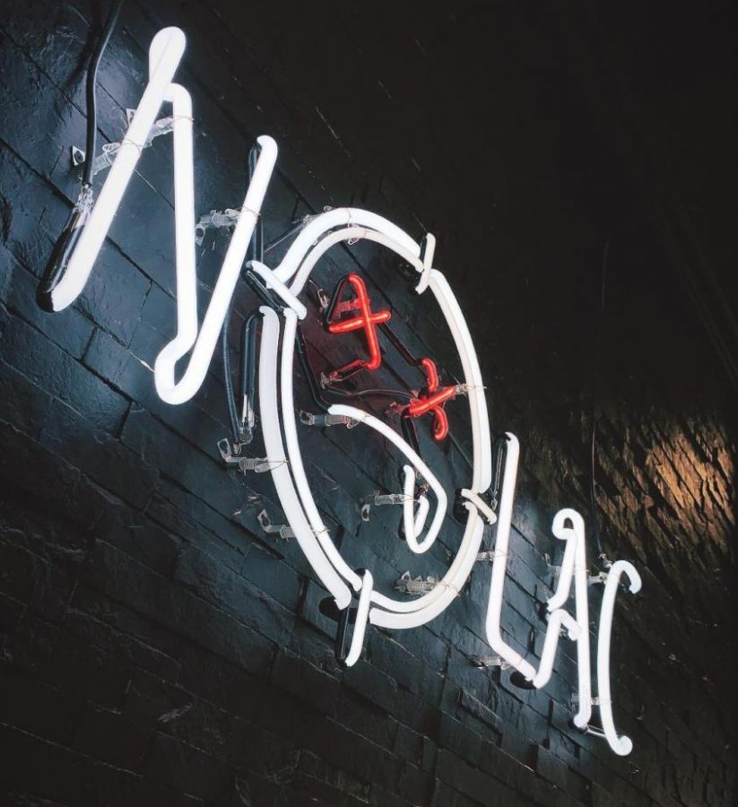 LIGHTING UP THE SOUTH SIDE, the NOLAC sign proudly hangs inside the brick and mortar store on E. Carson St.