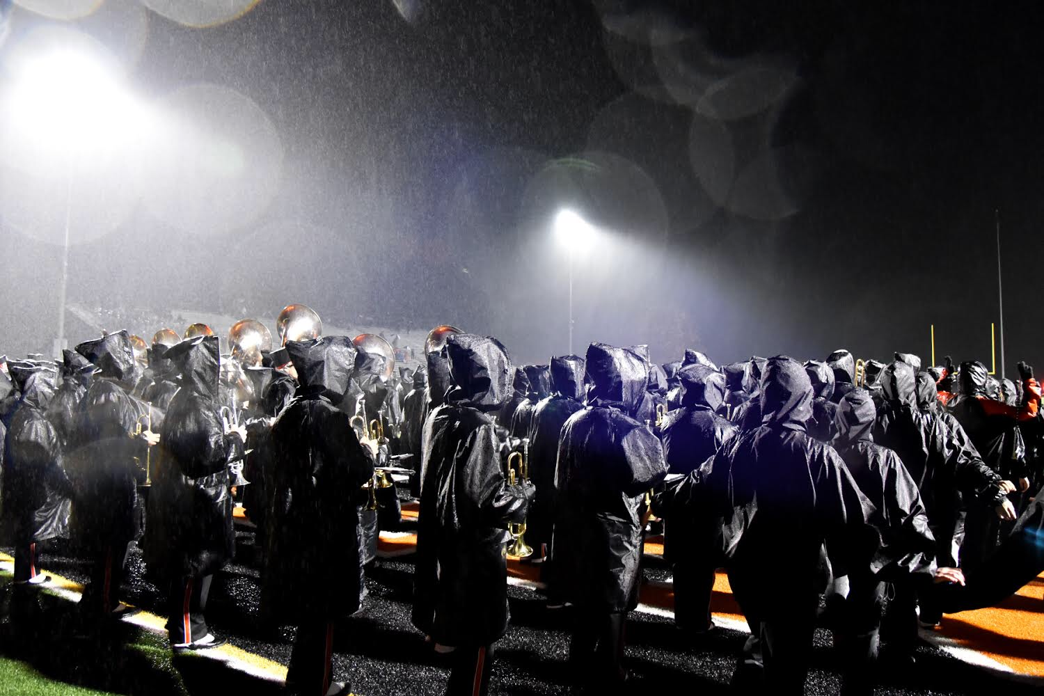 ANXIOUS TO PERFORM IN THE RAIN, the marching band is ready to do their first performance of the year in the rain.