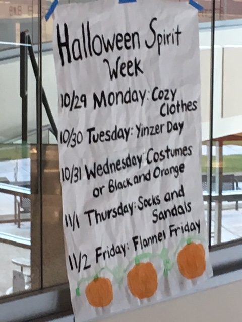 GOT SPIRIT?  A sign hanging above the cafeteria lists the spirit days for Halloween Spirit Week, which begins Monday, Oct. 29.